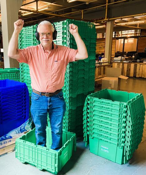 Atlas employee standing in box
